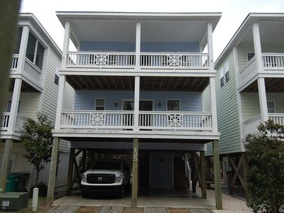 Photo for 4bed,3bath,short walk to beach,4 decks with ICW&beach views dock and pool