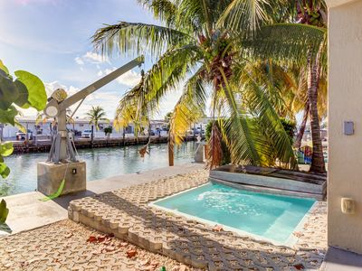 Photo for Waterfront half-duplex w/ 30-ft dock, sitting pool, and private beach access!