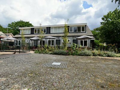 Photo for Modern holiday home with terrace on holiday park on the edge of the Veluwe