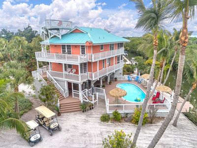 Photo for Rum Cove - Pool - 2 Golf Carts - 2 Slips - Airstrip Priv. -sleeps 10 in beds!