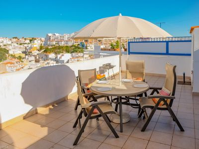 Photo for Nice cozy city house in Albufeira old town with terrace and view
