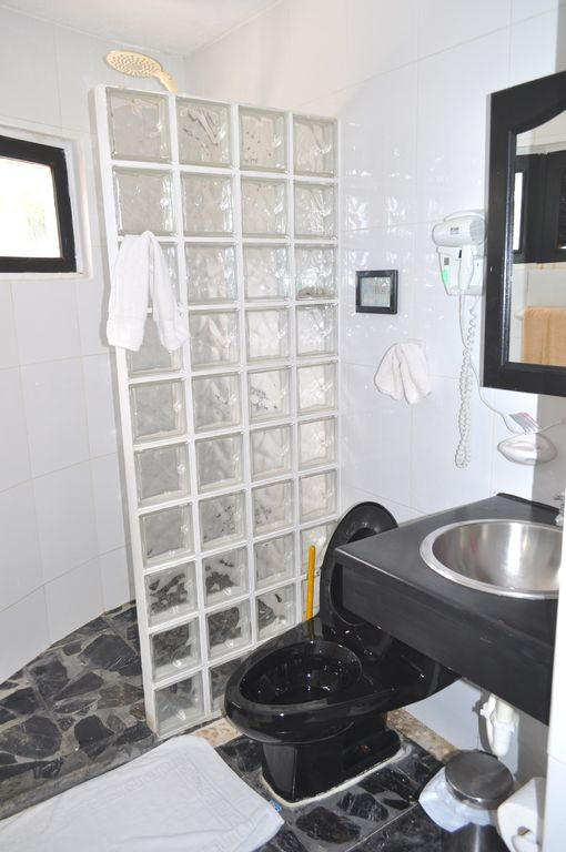 Villa Flamingo Bathroom. A Gorgeous View Of The Beach From The Shower.