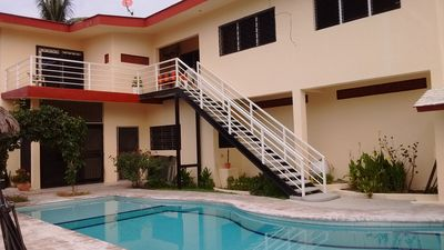 Photo for Family friendly , big swimming pool, with a private patio