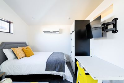 Sleeping Area - Sleep soundly on a heavenly queen bed, appointed with hotel-quality linens.