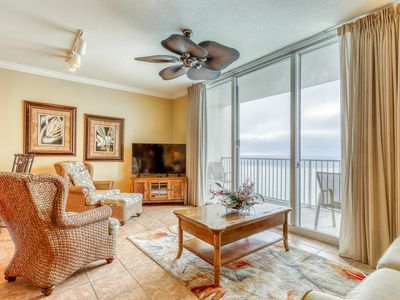 Photo for Classy condo w/ pools, hot tub, and fitness room - steps from the beach!