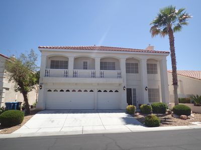 Photo for UPSCALE, QUITE, PRIVATE FAMILY STYLE HOME. W/ POOL & SPA, 5 BR, MINS FROM STRIP