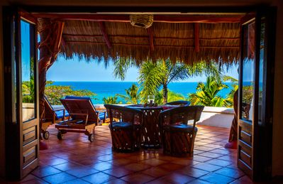 The front of the casitas open up onto your private patio with ocean view.