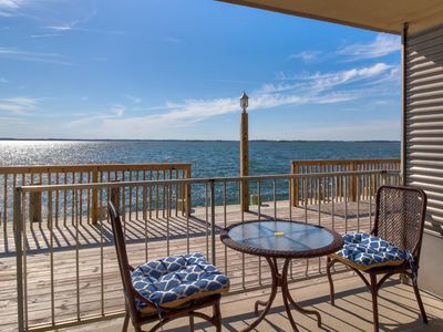 Photo for Waterfront condo w/ a full kitchen & furnished patio - close to the state line