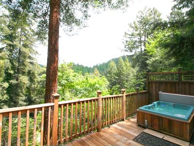 Photo for Wonderful Cottage sitting above the river! Hot Tub! 15% thru April!