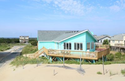 Photo for 50 steps to the beach. Very nice living room with ocean views.