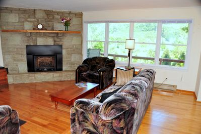 Living room with gas log fireplace.