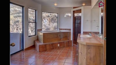 Master bath with two person jetted tub and walk-in shower with a view!