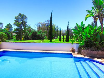 Photo for 1099 First Line Golf Family Villa San Pedro pool lounge area