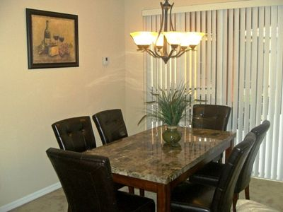 Formal Marble dining table with 6 leather chairs
