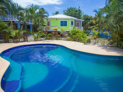 Photo for Idyllic Beachfront Bungalow with Pool in Popular Sandy Bay