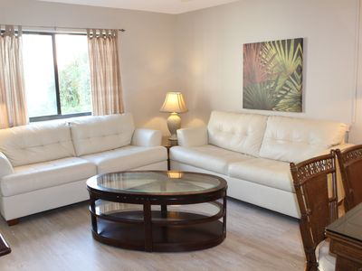 This comfy living space with tile floors and leather furniture provides a cool respite on a hot day.