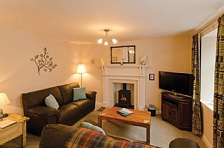 Living room with gas log burner - very cosy!