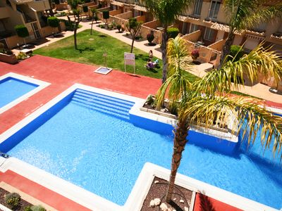 Photo for Pool view, centrally located, short walk to beach, bars and restaurants