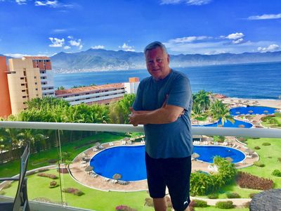 OWNER DON ENJOYING THE CONDO BALCONY WITH A VIEW OF PARADISE