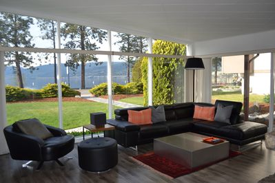 Enjoy our modern sun filled living room with wrap around windows