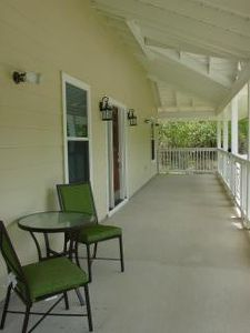 view of front southern plantation porch. There is no real back yard