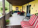 Private Deck w/ Luxurious Padded Chairs with Ottoman Foot Stools
