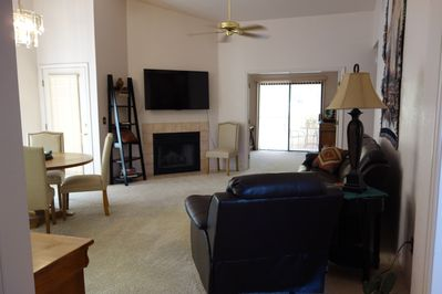 Our open concept liviing/dining room has a fireplace, mini library & lg screen t
