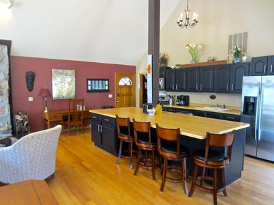 Open kitchen to great room and includes all necessary amenities to drink/cook