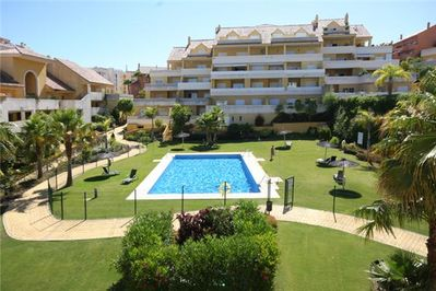 The urbanisation surrounds a large central landscaped pool