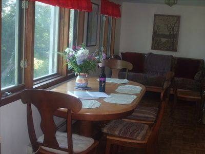 The dining area, looking from the kitchen. Those south windows have water views