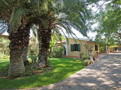 Photo for 4 bedroom Villa, sleeps 12 with Air Con, FREE WiFi and Walk to Beach & Shops
