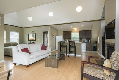 Open floor plan with high ceilings and lots of light.