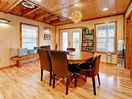 Dining Area  - Immaculate hardwood flooring features throughout your cabin-style retreat.