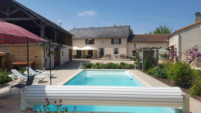 Photo for Grande Maison des Tournesols. 5 bedroom gite with heated private pool, sleeps 11