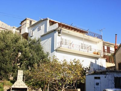 Photo for Two bedroom apartment with balcony and sea view Sumpetar, Omiš (A-9435-a)