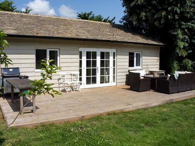 Relax on the sunny decking and enjoy a BBQ