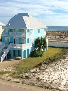 Photo for Bahama style Beach house, steps from Beach, Pool, Bay pier, Gated neighborhood