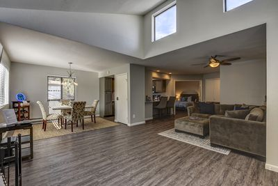 Living Room/Dining Area with vaulted ceilings and an abundance of natural light
