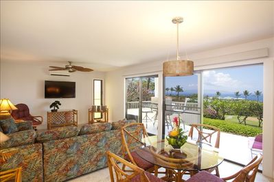 Dining area into living room with the large lanai and its outstanding views.