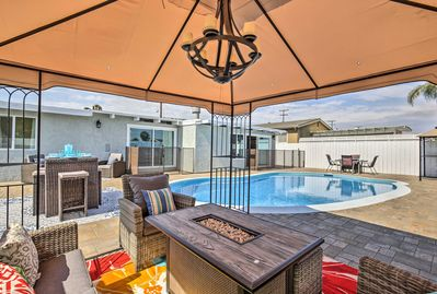 Unwind under the shaded cabana beside the gas fire pit.