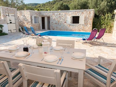 Photo for The picturesque stone holiday house with private pool