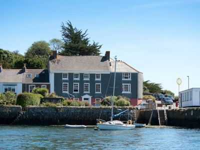 Photo for Amazing location, right on the waters edge overlooking Falmouth Harbour