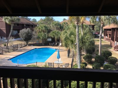 Beautiful upstairs condo with a pool view.