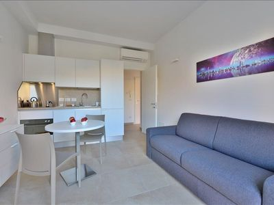Photo for Bright, modern apartment steps from Piazza Maggiore