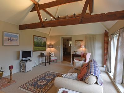 Photo for The Courtyard is a spacious but cosy cottage, in Suffolk, that welcomes dogs