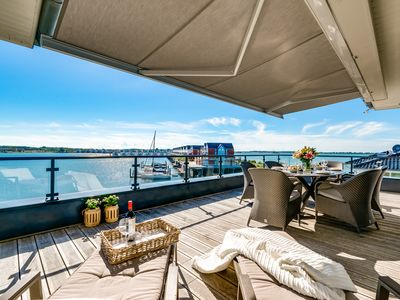 Photo for Luxury penthouse on the waterfront with surrounding sun terrace, sauna and fireplace