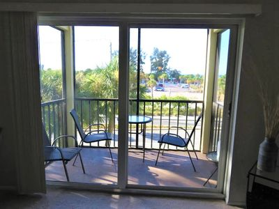 Great Siesta Beach View! End unit with open kitchen; Fans. See the sunset here for your vacation.
