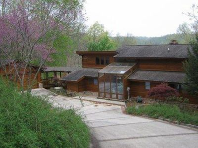 "Photo for ""Sunset Shores""  Private lakefront log home at Deerfield Resort, sleeps 16"