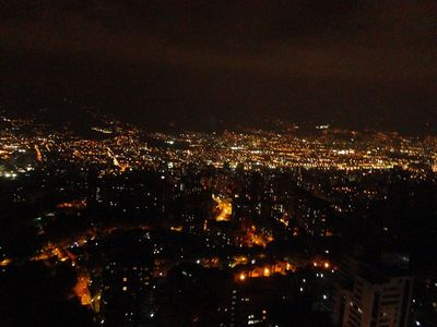 you waited here it is Medellin at night balcony view