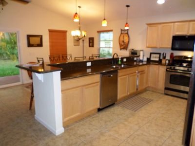 Nice open kitchen with seating high top
